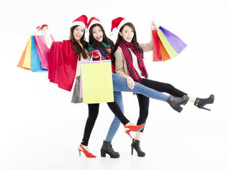 chicas comprando: Happy young woman group enjoy Christmas shopping