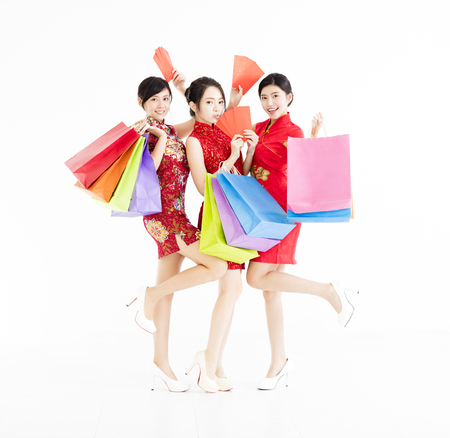 young group holding shopping bags and happy chinese new year . Stock Photo