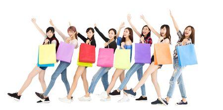 asian girl shopping: Happy young woman group enjoy  shopping