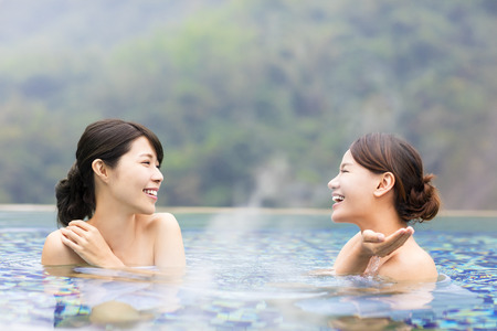 happy young woman relaxing in  hot springs Stock Photo