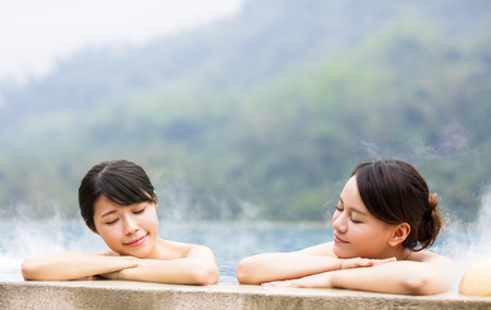 happy young woman relaxing in  hot springs 写真素材