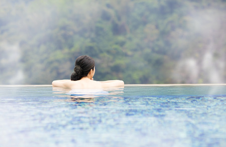 young woman relaxing in  hot springs 写真素材
