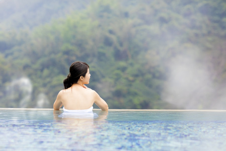 thermal spring: young woman relaxing in  hot springs Stock Photo