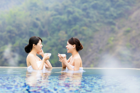 hot springs: happy young woman relaxing in  hot springs Stock Photo