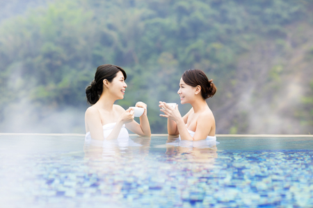 happy young woman relaxing in  hot springs 스톡 콘텐츠
