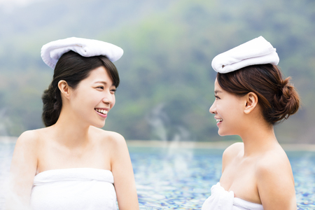 thermal spring: happy young woman relaxing in  hot springs Stock Photo