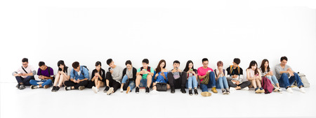 mobile technology: young student Group watching smart phone Stock Photo