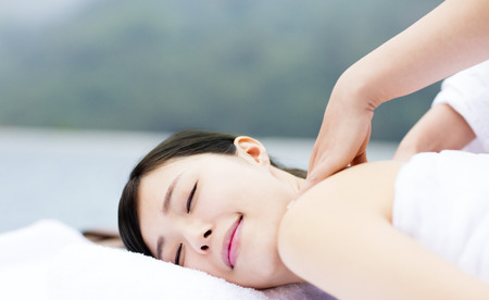 young woman in spa salon getting massage Stock Photo