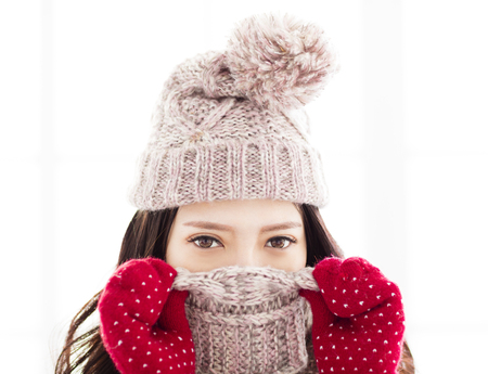 young  woman with smiling eyes wearing winter clothes