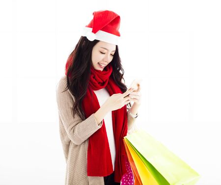 lady on phone: young woman  enjoy Christmas shopping with smart phone Stock Photo