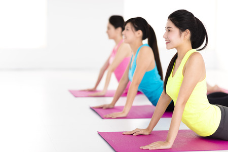 happy young woman Group  doing yoga exercises Imagens - 69820202