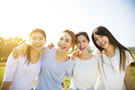 friend hug: Group of young beautiful women smiling Stock Photo