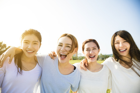Group of young beautiful women smiling