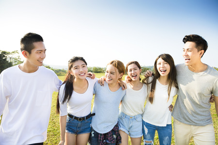 happy young asian group walking together