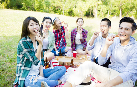 happy young friends enjoying  healthy picnic Stock Photo