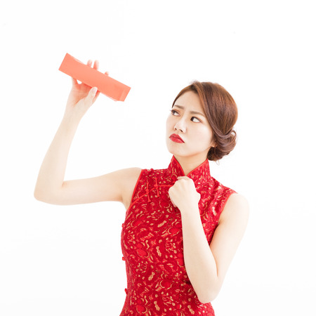 envelope: stress chinese woman watch the empty red envelope Stock Photo
