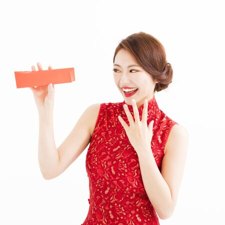 envelope: happy young chinese woman watch the  red envelope Stock Photo