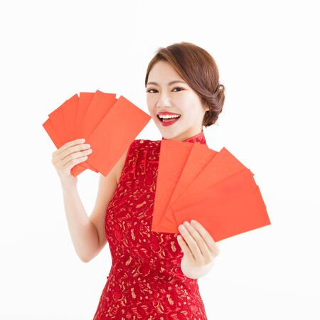envelope: happy woman wear cheongsam and showing Red envelopes