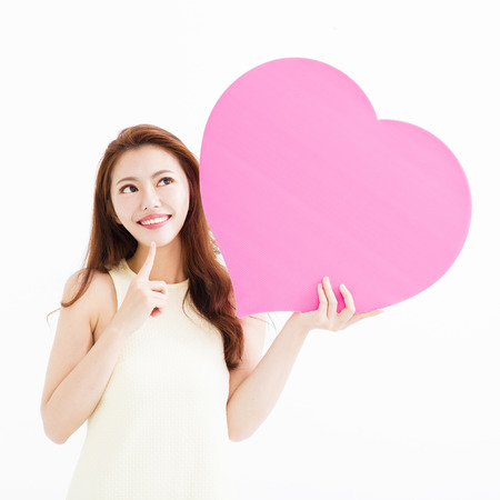 Beautiful woman in love and holding heart shape