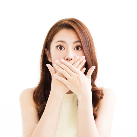 young asian woman with surprised gesture Imagens