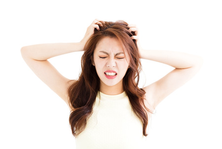 young Woman stressed  going crazy and pulling her hair