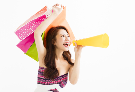 woman with shopping bags and holding megaphone