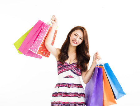 shopper: young happy smiling woman with shopping bags