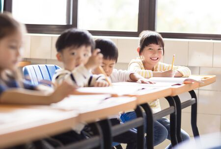 happy little girl student  in the classroom photo
