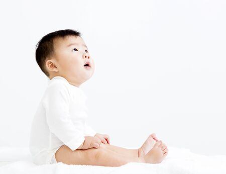 1: Adorable asian   smiling  baby  boy looking up Stock Photo