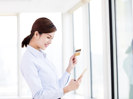 young woman shopping with credit card and smart phone Stock Photo