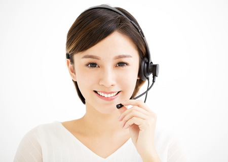 Smiling young business woman with headsets