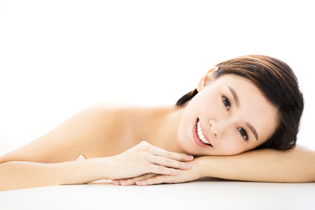 Beautiful woman  lying down on towel during skin care treatment