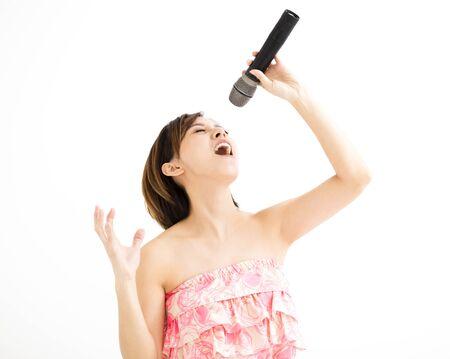 beautiful young woman singing karaoke isolated on white  Stock Photo