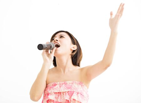 asia people: beautiful young woman singing karaoke isolated on white Stock Photo