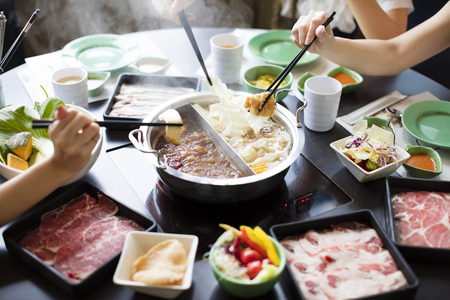 chinese foods Double flavor hot pot on the table 스톡 콘텐츠