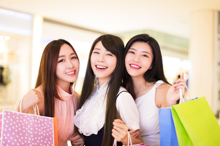 happy woman group holding shopping bags at  mall Stock Photo
