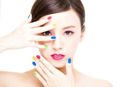 nails: closeup Beauty Girl face with Colorful Makeup concept