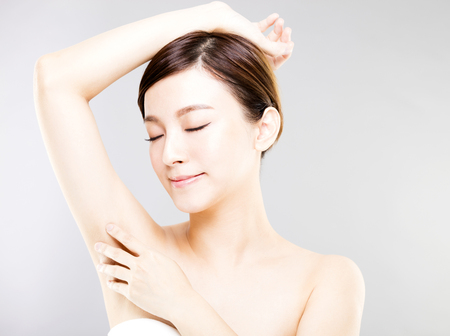 armpits: Young beautiful woman with perfect skin and armpits care