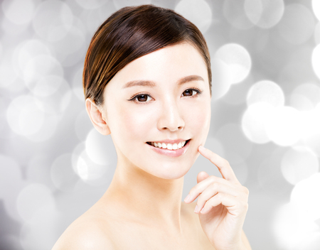 closeup   young  woman face with blur background