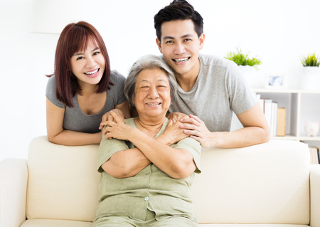 couple on couch: happy young couple with grandmother