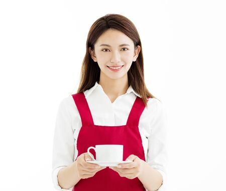 white work: Young  woman smiling and showing cup of coffee   Stock Photo
