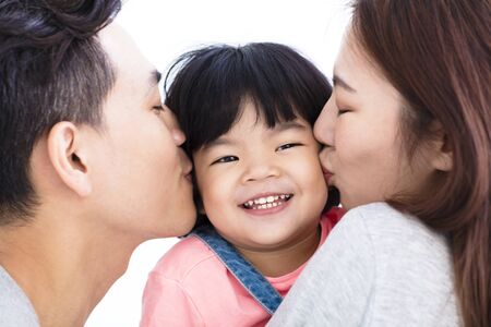 home: happy asian parents kissing little girl Stock Photo