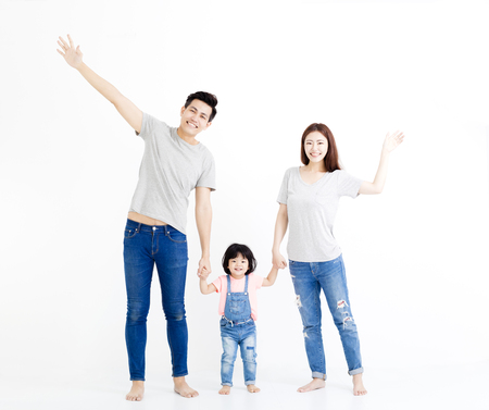 happy asian family  standing together isolated on white