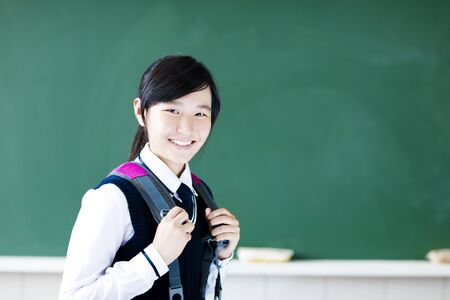 smiling  teenager student girl in  classroom photo