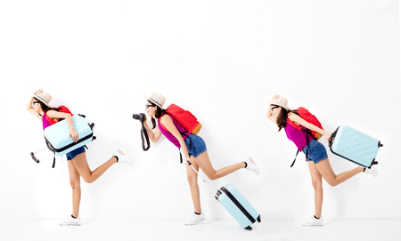 vacation summer: Happy young woman holding suitcase  and running for travel Stock Photo