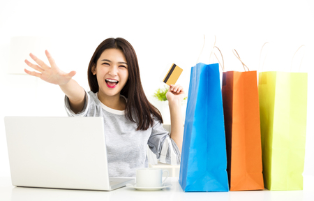 Young Woman showing credit card And Shopping Online Stock Photo