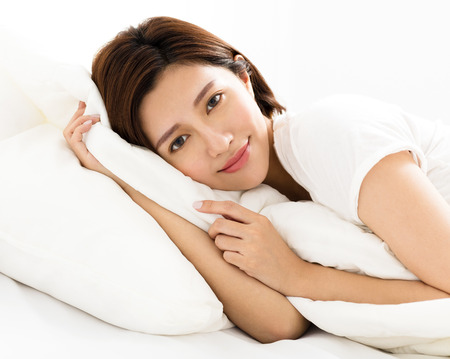 one sheet: young beautiful woman sleeping in the bed