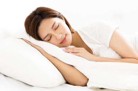 comfortable: young beautiful woman sleeping in the bed