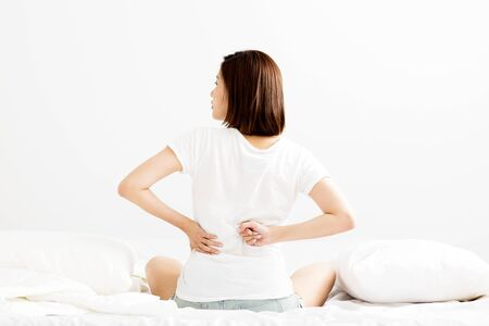 woman have  backache on white bed  in morning