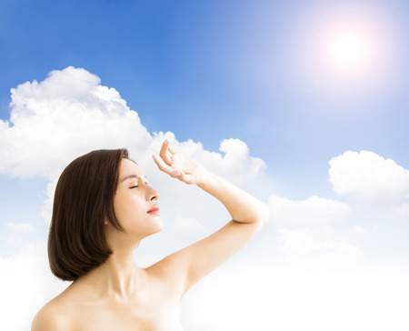 young woman with sunlight .skin care and sun block UV  concept